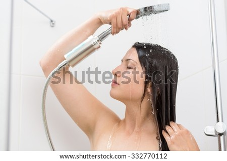 Photo of young beautiful woman taking relaxing shower