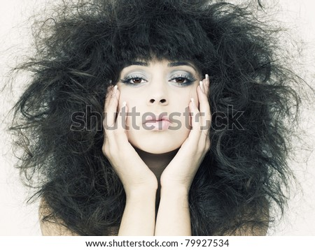 Photo of young beautiful woman with magnificent dark hair - stock photo