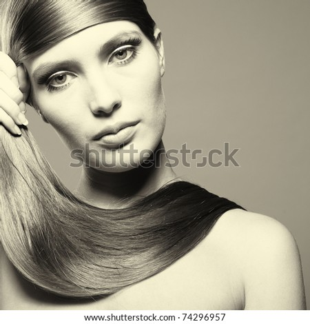 Photo of young beautiful woman with magnificent hair