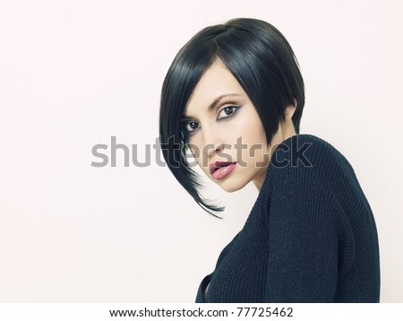 Photo of young beautiful woman with short hairstyle - stock photo
