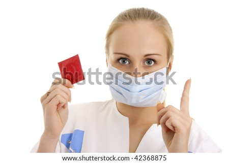 Photo of young doctor with condom in her hand. Isolated. - stock photo
