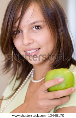 Photo of young girl with green apple