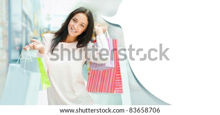 woman with shopping bags on the background of shop windows at mall ...