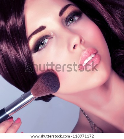 Photo of young sexy lady with perfect makeup, closeup portrait of pretty woman apply tassel to doing cute blush, cosmetics tools, beauty salon, Christmas eve, New Year party, gorgeous lifestyle