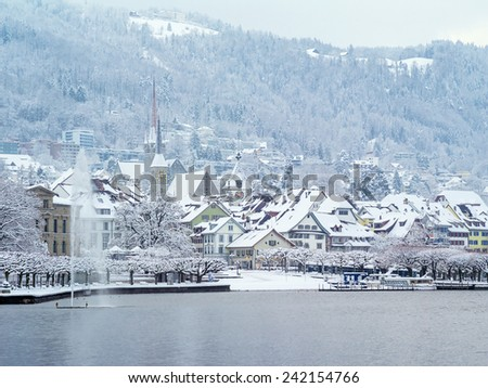 Photo of Zug Switzerland in January after a long snowstorm. Photo taken December 31, 2014. - stock photo