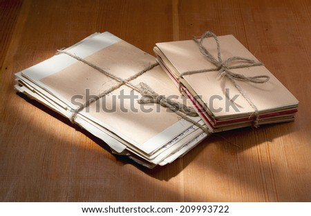 photo old letters two packs tied up by a twine - stock photo
