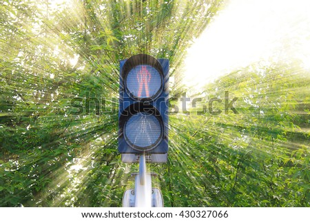Photo on which depicts the traffic light at the intersection. - stock photo