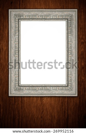 Photo or painting frame on wooden background. - stock photo
