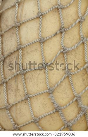 Photo pile of old fishing nets closeup - stock photo