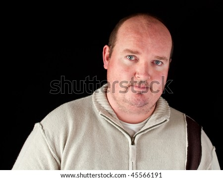 photo portrait of a overweight male on black