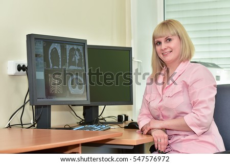 Photo-portrait of a specialist in imaging at the computer, studying the radiograph of the patient