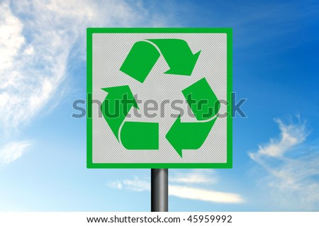 Photo realistic metallic reflective road sign, depicting the green and white recycling logo, against a blue sky. - stock photo