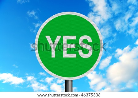 Photo realistic metallic reflective 'yes' road sign, against a bright blue sky