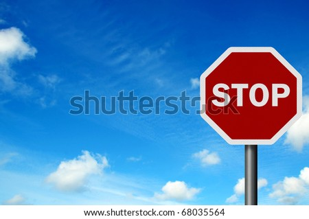 Photo realistic 'stop' sign against a bright blue sky - stock photo