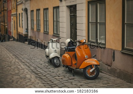 Photo retro scooters in the old town of Stockholm. Effect retro film - stock photo