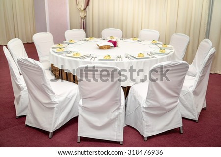 Photo round dining table served for twelve people. - stock photo