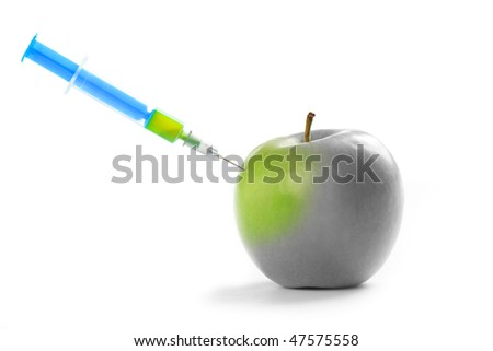 photo shot of injection vitamin in apple