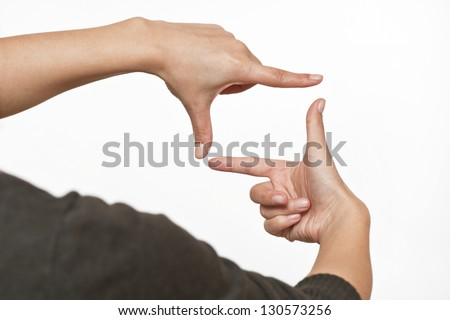 Photo sign made by human hands on white background - stock photo