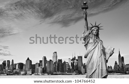 photo statue of liberty new york city black and white hi contrast. nyc new york city skyline over Manhattan cityscape midtown. statue of liberty over hudson river in new york city.