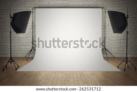 Photo studio equipment with white background - stock photo