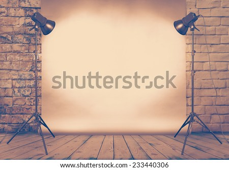 photo studio in old grunge room with brick wall and paper background, retro filtered, instagram style - stock photo