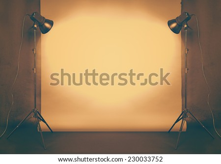photo studio in old grunge room with concrete wall and paper background , retro filtered, instagram style - stock photo