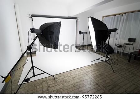 Photo studio setup with lighting equipment - stock photo