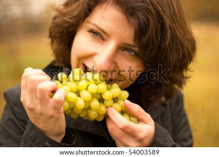 Photo. This is beautiful girl with vine. - stock photo