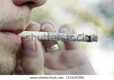 Photo where the man smoking a cigarette with the pictures of his life - stock photo
