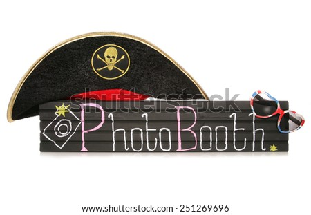 Photobooth sign with pirate hat and sunglasses cutout - stock photo