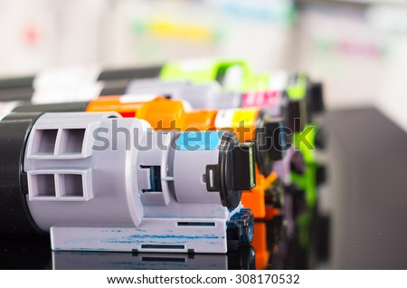 Photocopier printer cartridges cmyk closeup shot, selective focus - stock photo