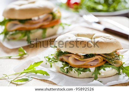 Photograph of a bagel sandwich with ham and cream cheese - stock photo