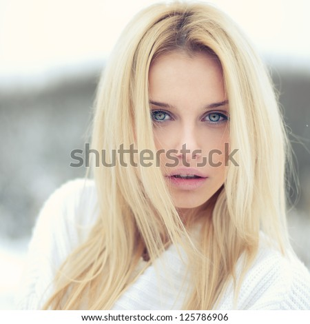 photograph of a beautiful young woman with a sexy look - stock photo