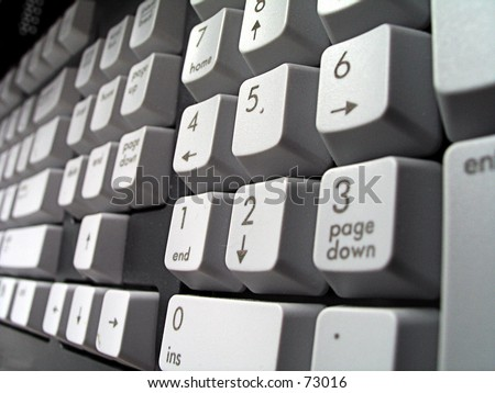 Photograph of a computer keyboard showing the numbers.  Taken with a shallow depth of field from right to left
