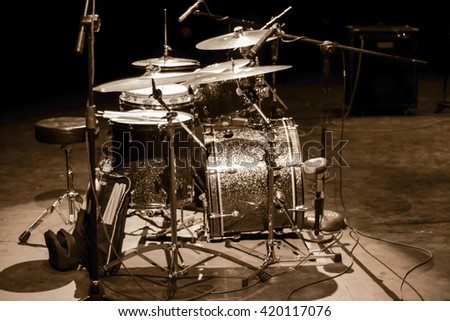 Photograph of a drums set on a stage