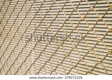 Photograph of a fence of metal protecting a window with a blind. Texture. Stock photography.