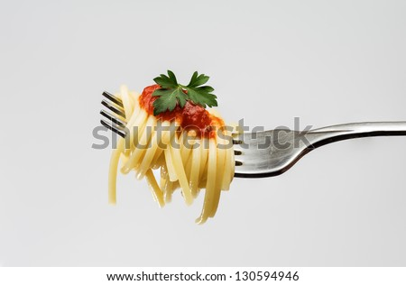photograph of a fork with spaghetti on white background - stock photo