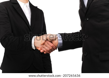 photograph of a handshake between a businessman and a businesswoman
