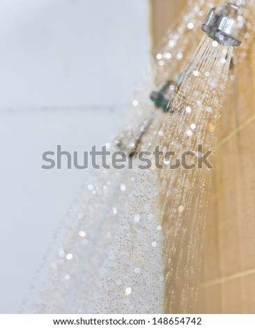 Photograph of a shower drops and streams of water