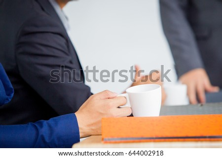 Photograph of a white coffee mug in the meeting room.