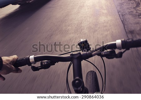 Photograph of an urban cyclist real view of the street