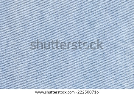 Photograph of Blue Cotton denim fabric crumpled texture sample. - stock photo