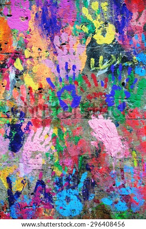 Photograph of colorful wall with collaborative hand prints - stock photo