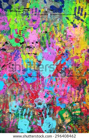 Photograph of colorful wall with collaborative printed hands - stock photo
