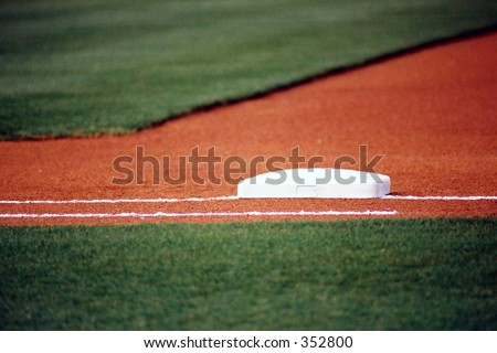 Photograph of first base before a baseball game. - stock photo