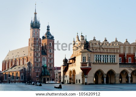 Photograph of main square in Krakow Poland. Krakow historical architecture: Mariacki church. - stock photo