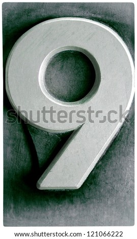Photograph of Metal Letterpress Number 9 - stock photo