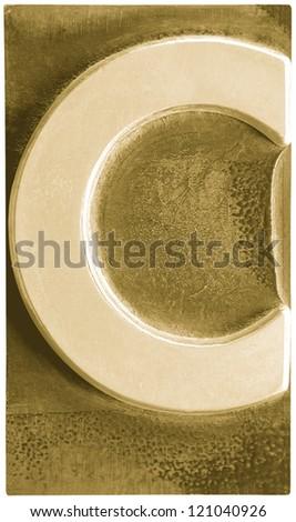Photograph of Metal Letterpress Sepia Letter C - stock photo