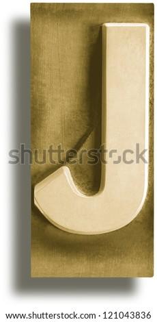Photograph of Metal Letterpress Sepia Letter J - stock photo
