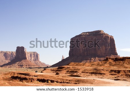 Photograph of Monument Valley right after sunrise. - stock photo